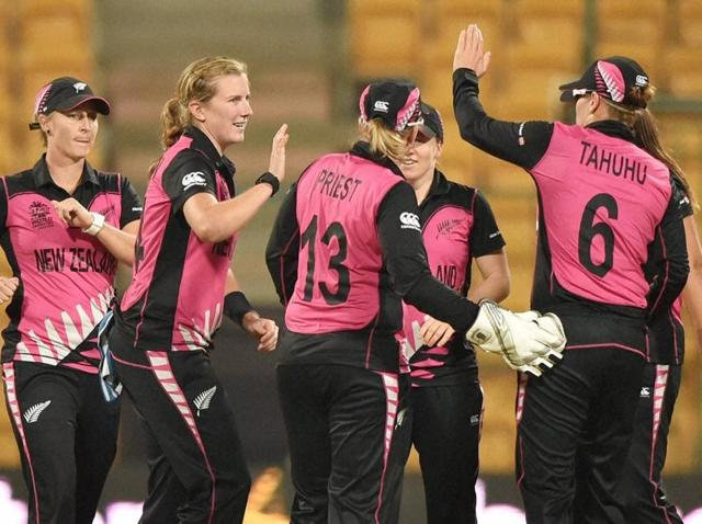 New Zealand's Sophie Divine shakes hand with South African team members after winning the ICC Women's World T20 match in Bengaluru on March 26, 2016.
