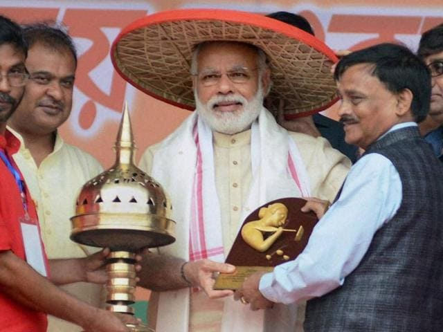 Prime Minister Narendra Modi was felicitated with traditional Assamese hat during an election rally in Sonitpur.