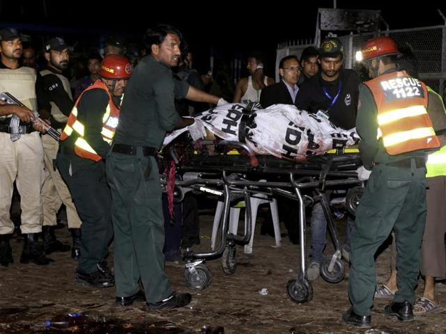 Pakistani rescuers carry a body in an ambulance from a bomb blast site in Lahore.