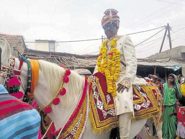 Groom Gangaram, the 42-year-old broom maker from Sendhwa during his wedding procession on Friday.(HT photo)