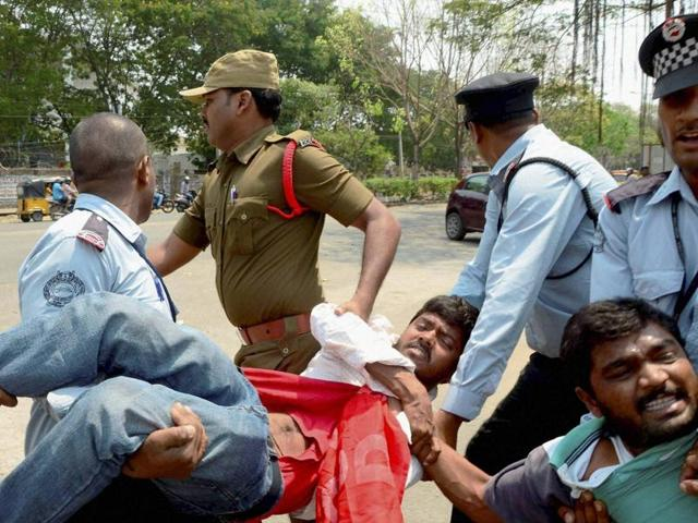 Security men taking away the students agitating for justice to Rohith Vemula at Hyderabad Central University on Saturday.