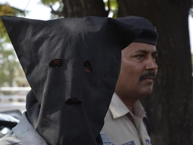 Rape accused Pramod Sharma in police custody.