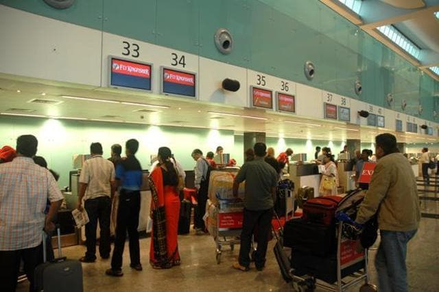 Passengers at the Kempegowda International Airport in Bangalore.