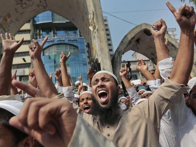Islamist leaders flash victory signs after the Bangladesh High Court rejected a petition challenging Islam as the state religion in Dhaka on Monday.