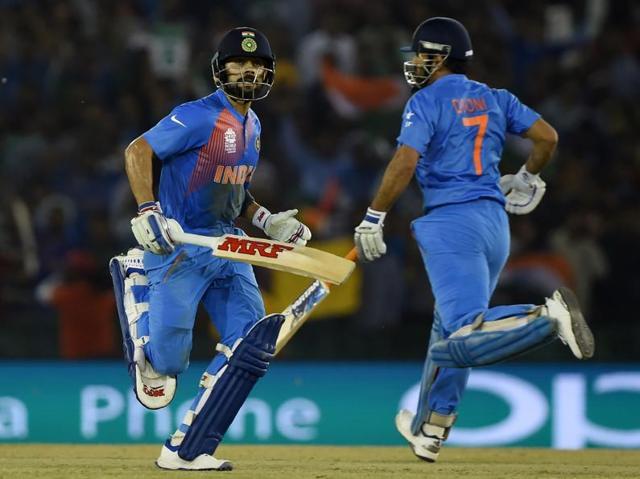 India's Virat Kohli touches gloves with captain Mahendra Singh Dhoni during the World T20 cricket tournament.