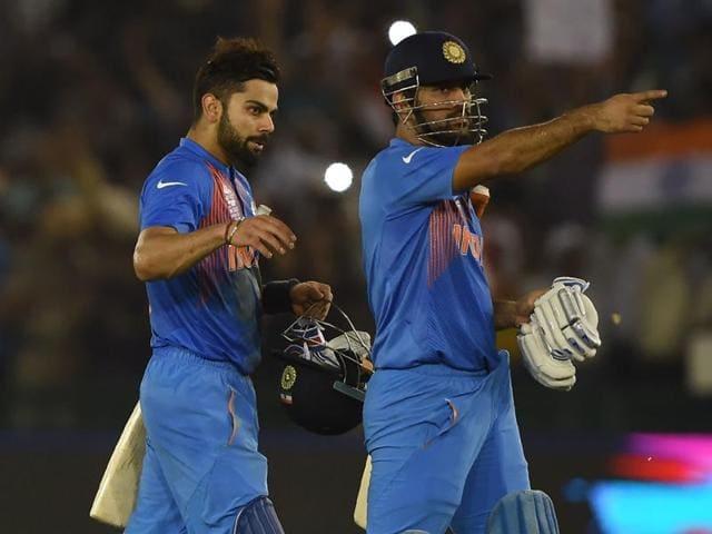 India's Virat Kohli (L) embraces captain Mahendra Singh Dhoni as he celebrates after victory.