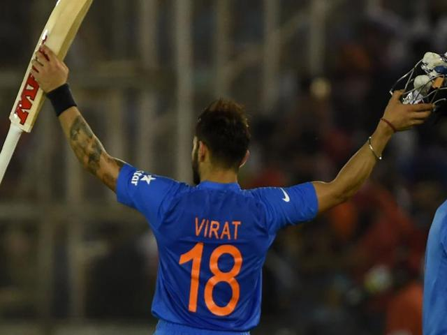 Virat Kohli celebrates after victory in the World T20 cricket tournament match between India and Australia at The Punjab Cricket Stadium Association Stadium in Mohali.(AFP Photo)