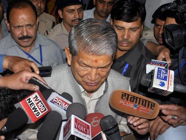 Uttarakhand chief minister Harish Rawat addresses the media outside the state assembly in Dehradun on Saturday, a day before the Centre declared President's Rule in the state.