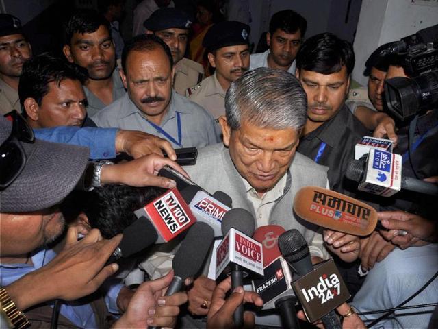 Former Uttarakhand Chief Minister Harish Rawat addresses the media outside the Assembly in Dehradun.
