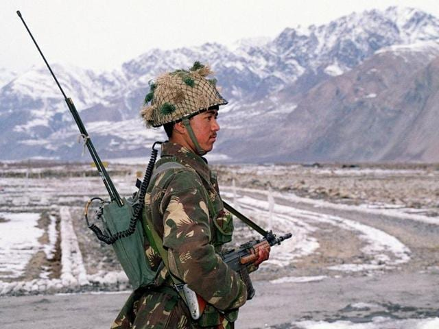 An Indian army soldier keeps vigil at the Indo-Pakistan border at Siachen.