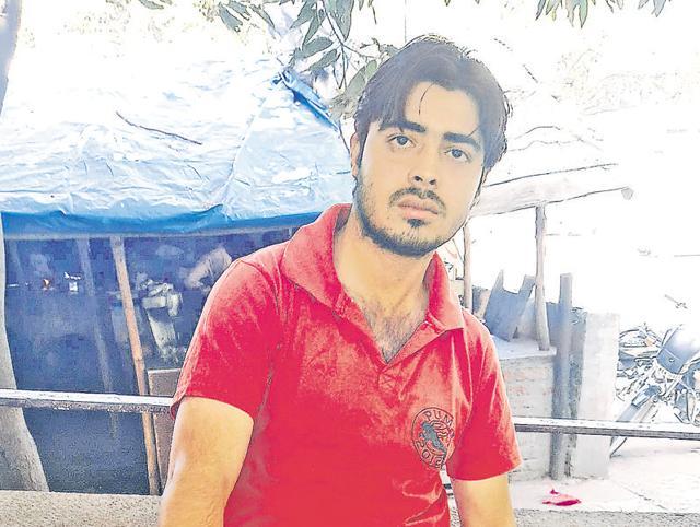 Shashi Kumar showing his injuries in Jalandhar on Sunday.