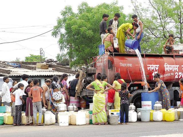 People taking water from a tanker at Anna Nagar in Bhopal.