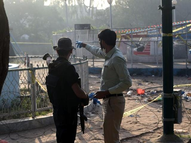 A Pakistani police commando walks at the cordoned-off site of the Lahore suicide bombing. Pakistan has launched a manhunt to fight the terrorists behind the March 27 suicide bombing, which killed at least 65 people.