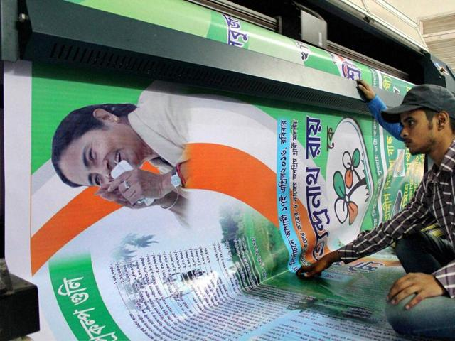 Workers making flex prints of TMC chief and West Bengal chief minister Mamata Banerjee ahead of assembly elections in Balurghat.
