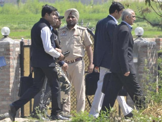 Members of Pakistan's joint investigation after coming out of the airbase at Pathankot on Tuesday