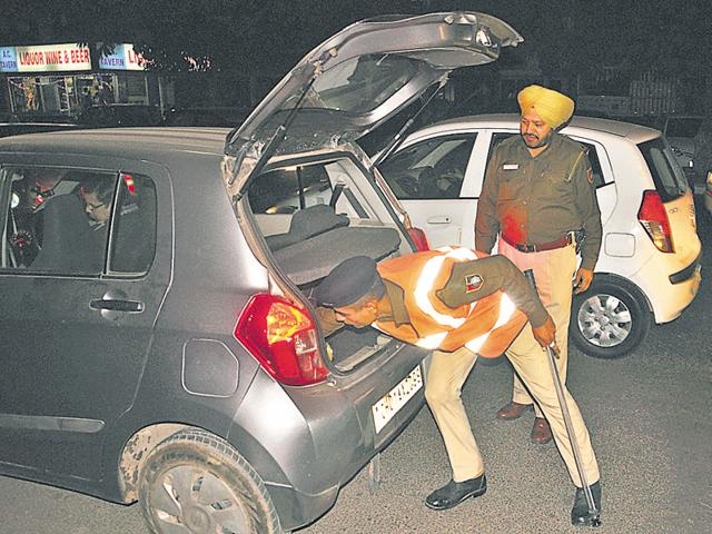 Police checking a vehicle during a checkpoint at Sector 19, Chandigarh.