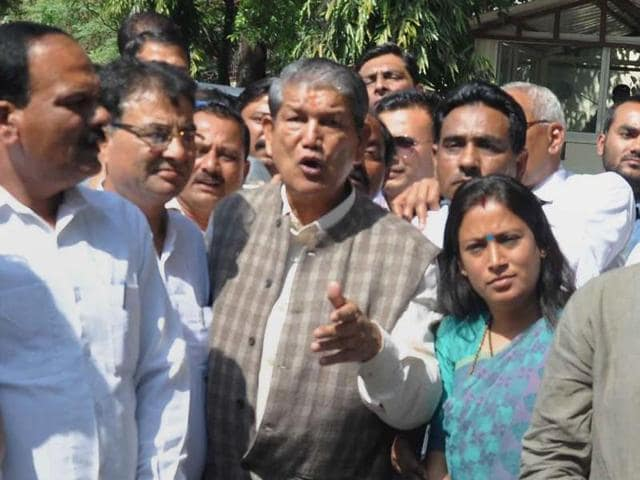 Deposed chief minister Harish Rawat along with Congress leaders and MLAs after meeting Uttarakhand governor KK Paul at Raj Bhawan in Dehradun.