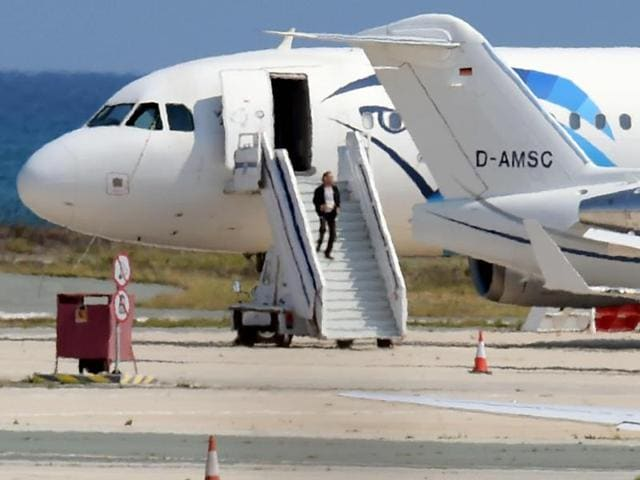 Passengers on the hijacked EgyptAir Airbus A-320 run on the tarmac after leaving the plane.