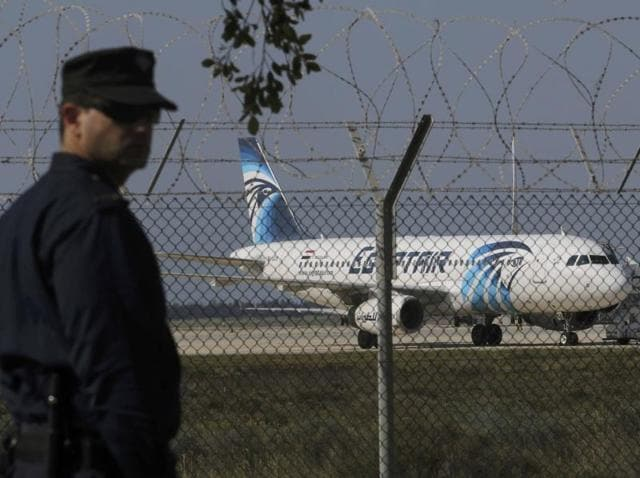 A policeman stands guard at Larnaca Airport near a hijacked Egypt Air A320 plane.