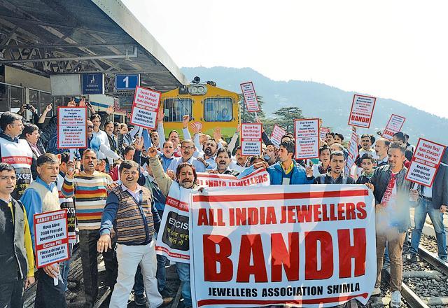 Jewellers blocking the Shimla-Kalka track at Shimla railway station on Monday.