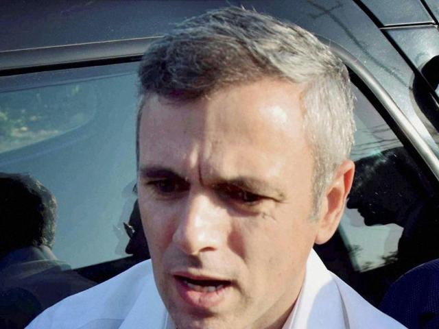 J& K National Conference Working President Omar Abdullah addressing the media outside Raj Bhawan in Jammu on Monday.
