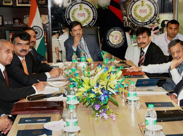 Members of Pakistan's Joint Investigation Team meet with the officials at the National Investigation Agency headquarters in New Delhi on Monday.