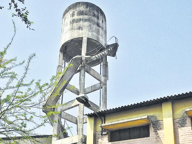 The water tank from where HMT's joint general manager Kamaljeet Singh Naagi (inset) jumped off in Pinjore on Monday.