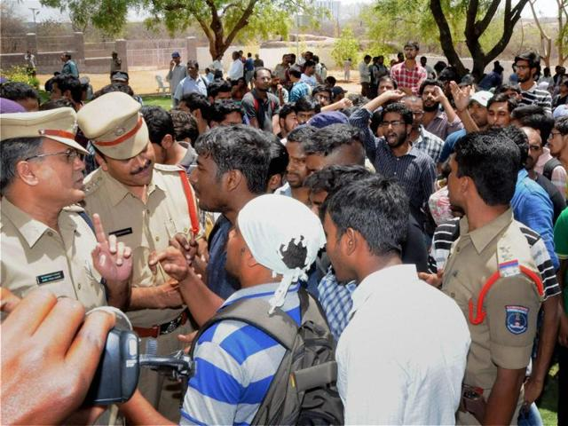 University of Hyderabad students speak to police officers during a recent protest on the campus.