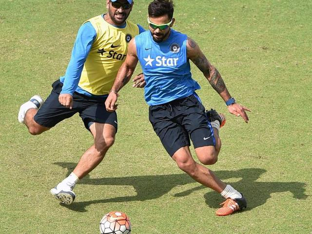 Virat Kohli plays football during a training session in Mohali.
