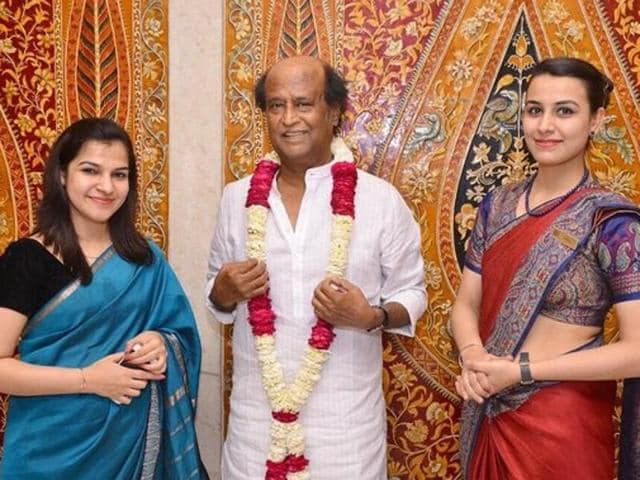 Rajinikanth poses with hotel staff on his arrival in Delhi on Tuesday.