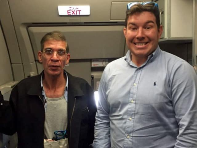 Ben Innes, 26, posed for a photo grinning next to the hijacker during the five-hour stand-off on Tuesday