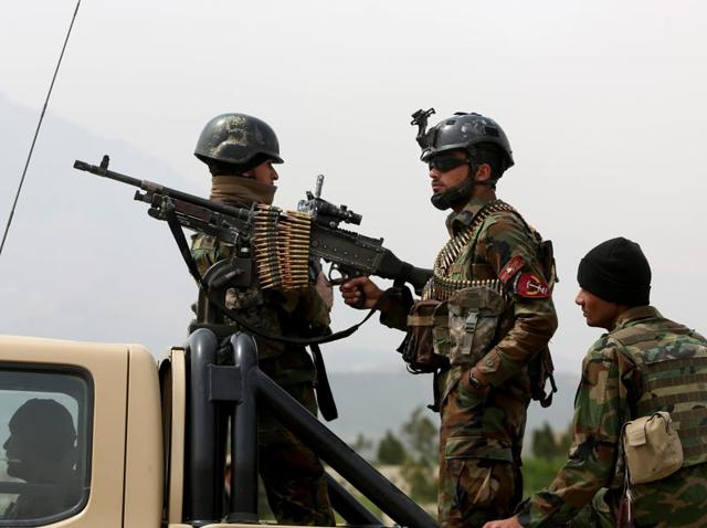 Afghan military soldiers stand alert at the entrance gate of the new parliament building after a rocket attack in Kabul, Afghanistan on Monday. The Taliban killed 15 Afghan soldiers during a firefight.
