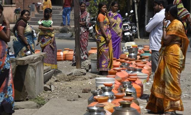 People lined up their pots to collect drinking water from government boring in Latur on  March 25, 2016.