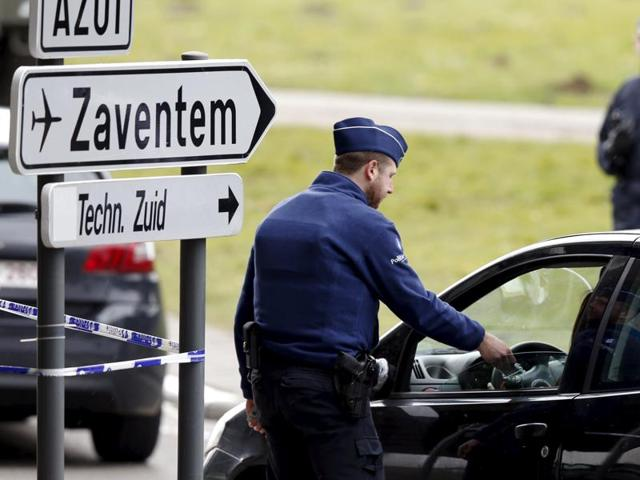 Belgian police officers control the access to Zaventem airport after the attacks last week in Brussels.