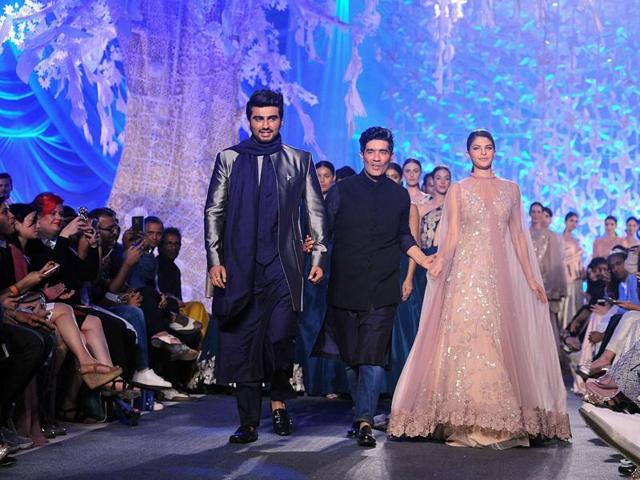 Jacqueline Fernandez and Arjun Kapoor showcase creations by designer Manish Malhotra at a Lakme Fashion Week Summer 2016 show in Mumbai.