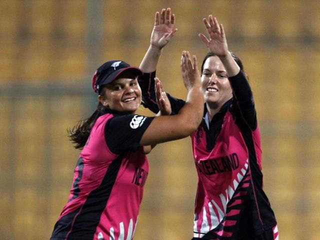 New Zealand's Erin Bermingham, right, celebrates with team captain Suzie Bates the dismissal of South Africa's Marizanne Kapp during their ICC Women's Twenty20 2016 Cricket World Cup match in Bangalore.