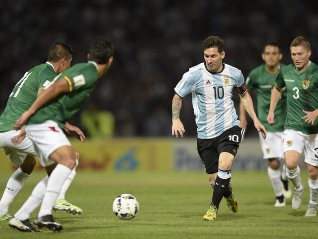 Argentina's Lionel Messi is marked by Bolivia's Alejandro Chumacero (C) and Jhasmany Campos during the Russia 2018 FIFA World Cup South American Qualifiers' football match in Cordoba.