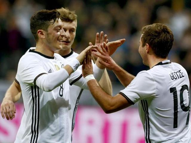 Germany's Mario Goetze celebrates with team mates after scoring the second goal against Italy.(Reuters Photo)