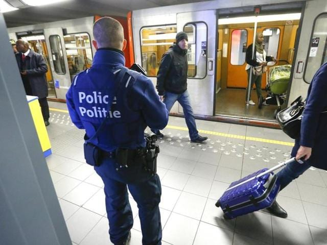 A Belgian police officer patrols in a metro station in Brussels, a week after the bomb attacks at the Brussels metro and Belgian international airport of Zaventem.