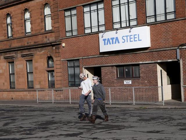Workers leave the Tata Steel plant in Motherwell, Scotland, Britain in this October 20, 2015 file photo.