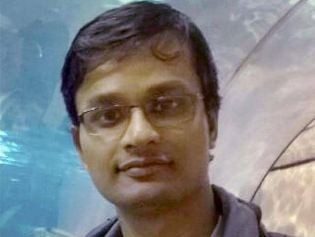 Brussels blasts victim Raghavendran Ganeshan's (inset) body being shifted to a hearse van at the Chennai airport on Tuesday.