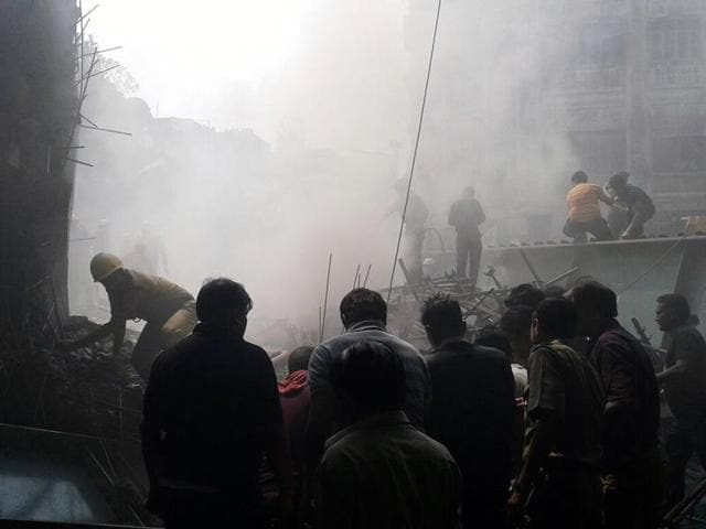 Rescuers search for survivors after a flyover under construction collapsed in Kolkata on Thursday.