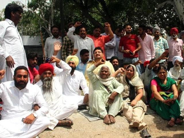 A file photo of people protesting against the state government at Moga civil hospital following the alleged molestation of a woman and her daughter on a bus.