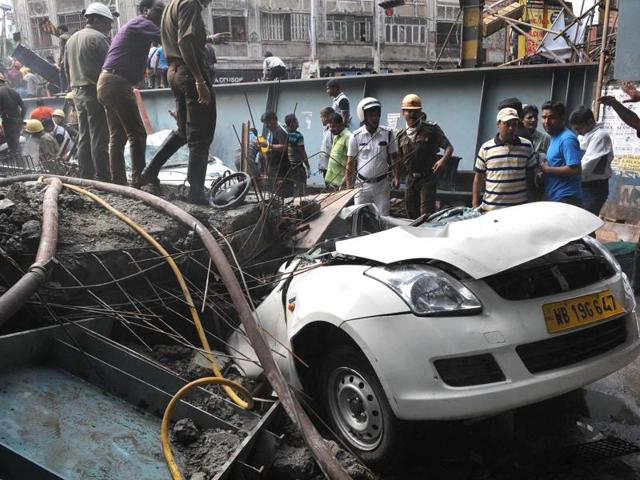 A large chunk, including girders, of the under-construction Vivekananda Flyover in the city's Posta area collapsed crushing people and vehicles.