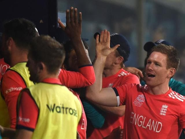 England's captain Eoin Morgan (R) celebrates after victory in the World T20 semi-final match between England and New Zealand at The Feroz Shah Kotla Cricket Ground in New Delhi on March 30, 2016.