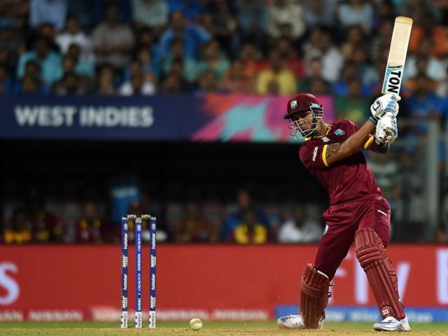 West Indies batsman Lendl Simmons plays a shot during the World T20 cricket tournament semi-final match between India and West Indies at The Wankhede Cricket Stadium in Mumbai on March 31, 2016.