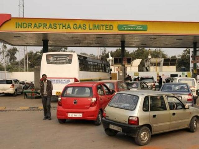 Cars parked in front of a gas station. On December 16, the SC had banned the registration of new diesel-guzzling luxury cars and SUVs with engine capacity of over 2000 cc until March 31.