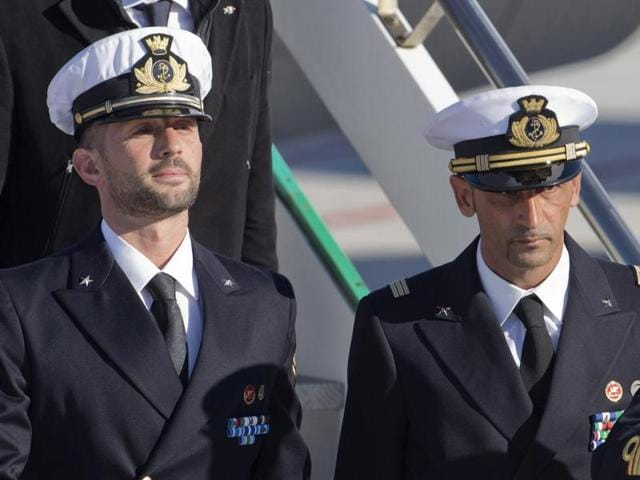 This 2012 photo shows Italian marines Salvatore Girone, left, and Massimiliano Latorre, who allegedly shot dead two Indian fishermen mistaking them as pirates,