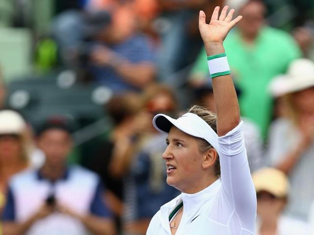 Victoria Azarenka (L) shakes hands with Johanna Konta (R) after their quarterfinal match of the Miami Open at Crandon Park Tennis Center in Key Biscayne, Florida on March 30, 2016.