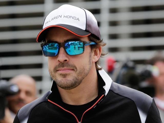 McLaren driver Fernando Alonso of Spain arrives at the Formula One Bahrain International Circuit.